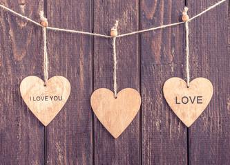 Heart's on dark wooden background. Flat lay. Valentine's day