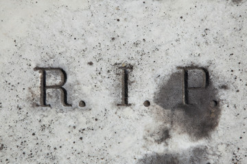 RIP. Rest in peace. Traditional inscription on the grave.