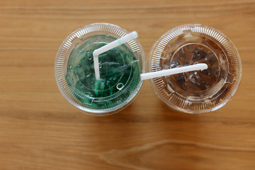 Pair of iced drinks: Kiwi Soda and Coffee