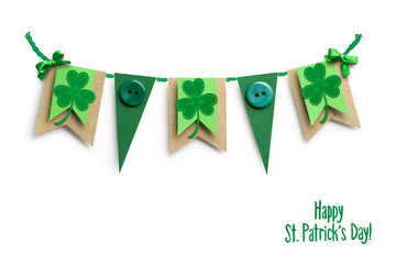 Good luck / Creative St. Patricks Day concept photo of flags with shamrocks made of paper on white background.