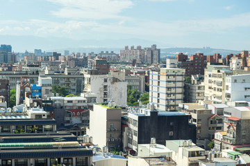 Business and culture concept - panoramic modern city skyline bird eye aerial view under dramatic morning blue cloudy sky in Taiwan