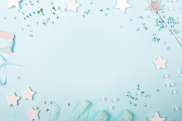 Blue Frame background with stylish decoration stars and sequins with copy space for text.