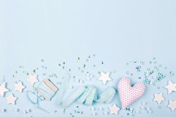 Stylish Frame border with cute decoration: heart, lace ribbon, stars and sequins with copy space for text on blue background