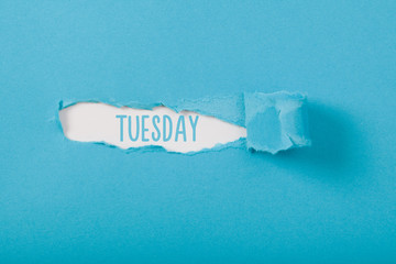 Tuesday, English weekday message on Paper torn ripped opening