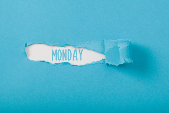 Monday, English weekday message on Paper torn ripped opening