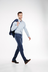 Vertical image of man in business clothes walking