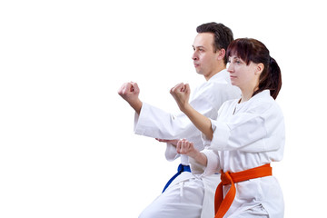 Two adult athlete standing in the rack karate