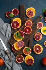 Citrus fruit background with sliced oranges