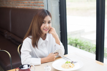 Asian beautiful women have lunch at restaurant.
