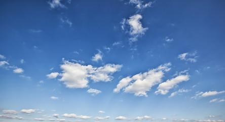 Grey clouds in the blue sky