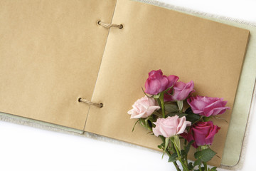 Bouquet of roses on open notebook