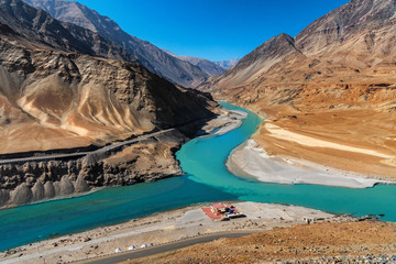 Confluence of the Indus and Zanskar Rivers are two different colors of water , between Kargil and leh,India