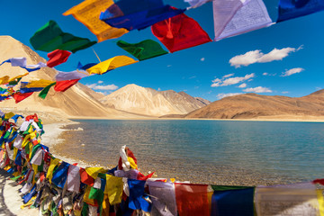Mountains and Pangong tso (Lake). It is huge and highest lake in Ladakh and blue sky in background,