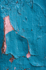 Creative blue pink colored background of plaster and brick with deep cracks and lines. Color ink disappears from the surface of the wall.