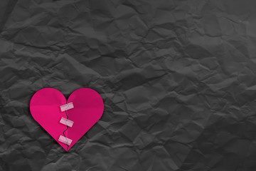 heart broke with tape fix and Crumpled fold white paper sheet background love problem concept
