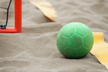 Handball ball on the beach in the sand
