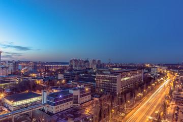 Fototapeta Night Voronezh city after sunset, blue hour, night lights of houses, buildings,