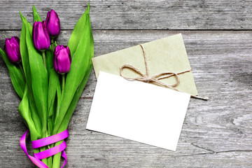 blank white greeting card and envelope with purple tulips