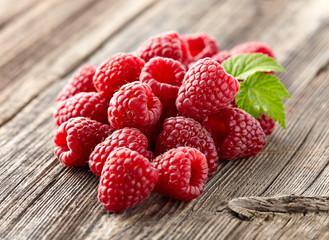 Fresh raspberry on a wooden background