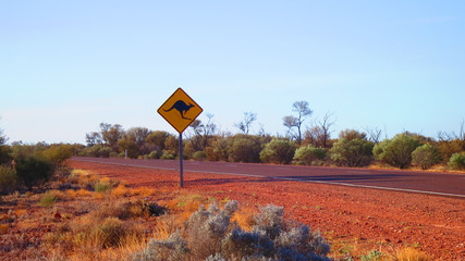 Kangaroo road sign on the Stuart Highway somewhere in the Outback center of Australia