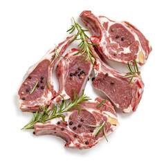 Raw Lamb Cutlets Top View Isolated with Rosemary and Peppercorns