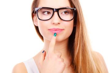 Nerdy teenage in eyeglasses thinking about something