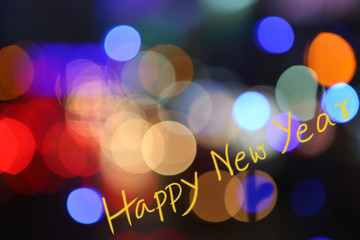 """Colorful of Bokeh light with word for """"Happy New Year"""""""