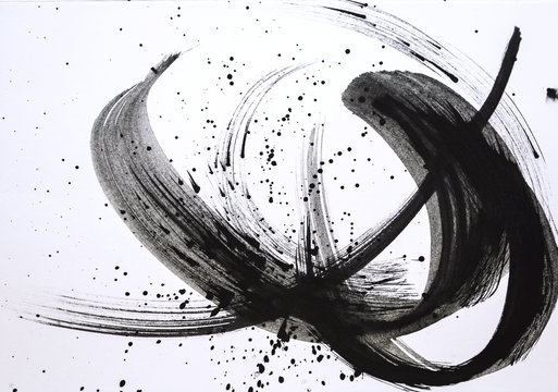 Abstract brush strokes and splashes of paint on paper