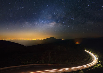 Milky Way Galaxy with lighting on the road at Doi inthanon Chiang mai, Thailand.Long exposure photograph.With grain