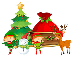Elves and snowman by the Christmas tree