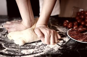 pizza prepare dough hand topping