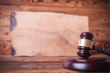 judge's gavel in front of a bog oak board