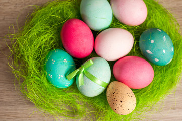Easter composition of colored eggs cooked for the holiday on the wooden background