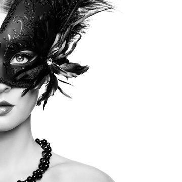 Beautiful young woman in black mysterious venetian mask. Black and White Fashion photo