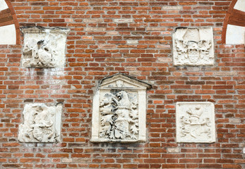 Coat of arms on the wall of The Domus Mercatorum  in Verona. Italy