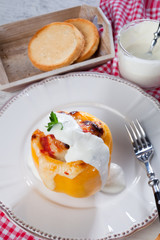Yellow stuffed pepper with chicken meat dressing with cream