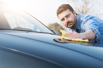 Man taking care and cleaning his car