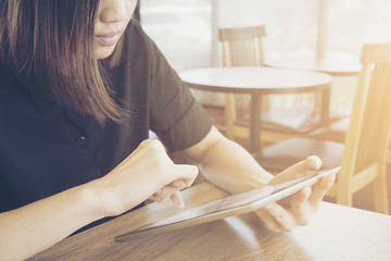 women in black shirt play tablet.:Idea for business or technology concept.