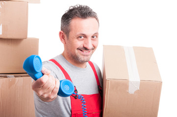 Selective focus of mover guy holding telephone receiver