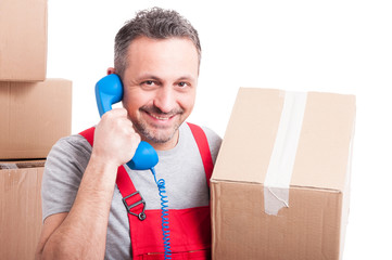 Mover man holding box and big telephone receiver