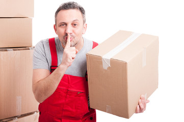 Mover man holding box and showing sush gesture