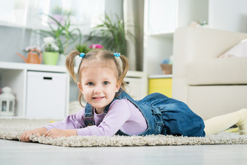 two years old baby lies on the floor