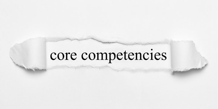 core competencies on white torn paper