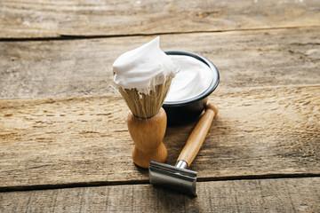 mens shaving kit on wooden background