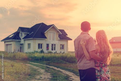 loving couple looking at their home stockfotos und lizenzfreie bilder auf bild. Black Bedroom Furniture Sets. Home Design Ideas