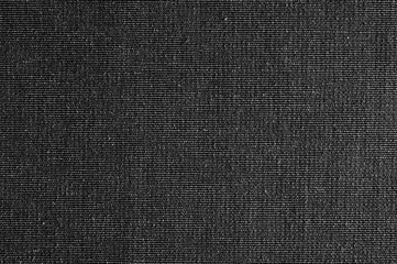 Closeup black color fabric texture. Fabric pattern design or upholstery abstract background.