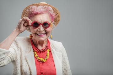 Funny senior lady looking at camera