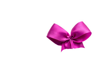 Pink ribbon satin bows isolated on white background
