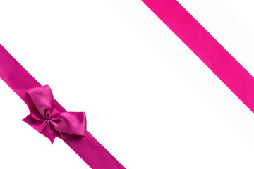 Pink ribbon with bow isolated on white background