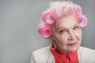 Smiling senior lady with extravagant makeup